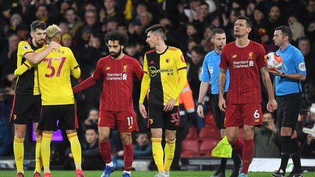 Pussetto junto a Salah, el día que el Watford le ganó 3-0 al Liverpool (EFE).